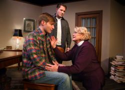 Chris Hester (as Tom) shares a difficult moment with his mother (Linda Beringer), putting her assistant Brandt (Chris O'Neill) in an awkward situation