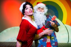 Carlotta (Dan Cimo) cavorts with a tropical Santa