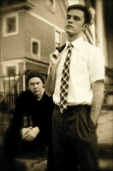 Dean Knight (left, sitting) as the older Tom and Deejay Gray (right, standing) as the younger Tom
